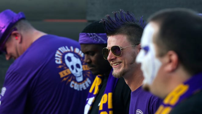 Patrick Arkenberg, sunglasses, and the rest of the Louisville City FC Drum Line gets the crowd cheering at a rally in support of a new stadium.