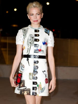 Michelle Williams arrives at the opening of architect Frank Gehry's latest creation, the Louis Vuitton Foundation art museum and cultural center in Paris, Oct. 20, 2014.