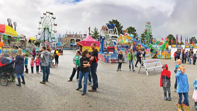 Fair goers attend the 169th Wayne County Fair. On Tuesday, Gov. Mike DeWine heavily limited activities at county fairs across the state.