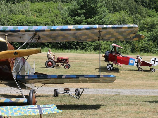 """A replica Fokker Dr 1 triplane is towed into position behind a replica Fokker D VII during the """"Meet the Fokkers Weekend"""" at Old Rhinebeck Aerodrome in Red Hook."""