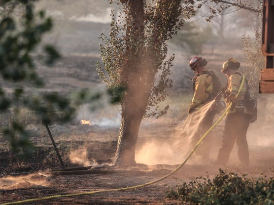 Fire crews knockdown hot spots along McCall Park Road in the San Bernardino Nation Forest during the Cranston fire on Wednesday, July 25, 2018 in the San Bernardino Forest.