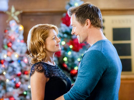 """Candace Cameron Bure, left, and Paul Greene star in Hallmark Channel's """"A Christmas Detour."""""""