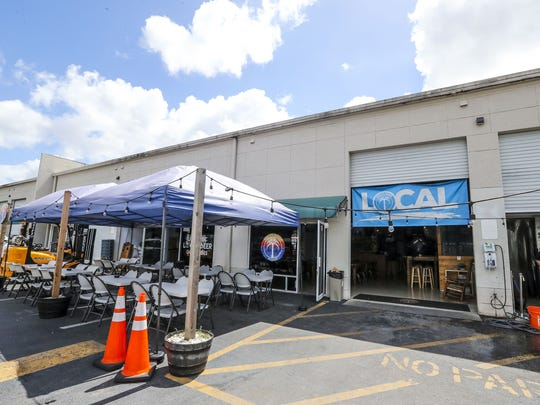 Naples Beach Brewery encourages people to drink local