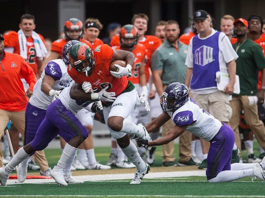 Colorado State tight end Cameron Butler, center, is tackled by Abilene Christian defenders on Saturday, August 9, 2017, in Fort Collins, Colo.