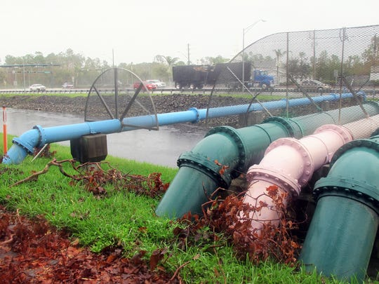 Multicolored utility pipes on Friday, Sept. 29, 2017, over the Cocohatchee Canal on the north side of Immokalee Road between Valewood Drive and Oakes Boulevard in North Naples.