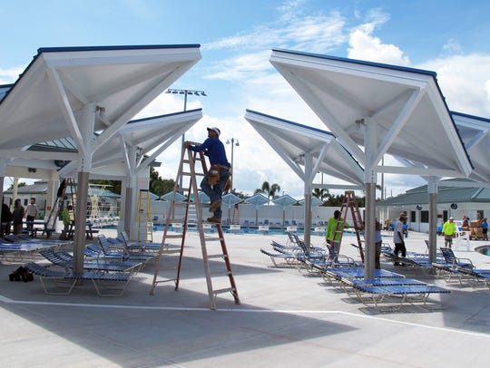 Workers put finishing touches on the new aquatic center