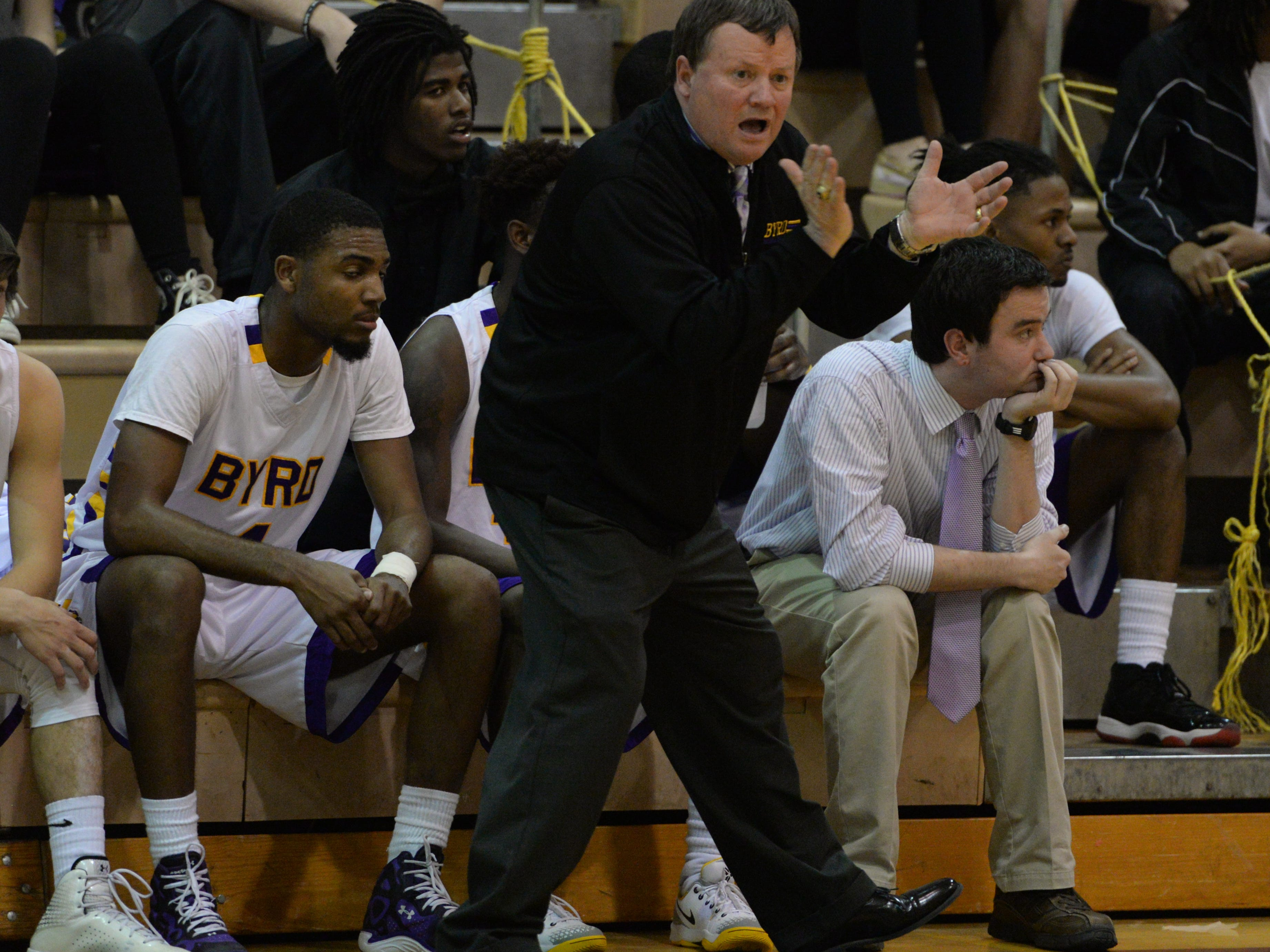 Byrd coach Rusty Johnson yells to his team during a win against Southwood this season.