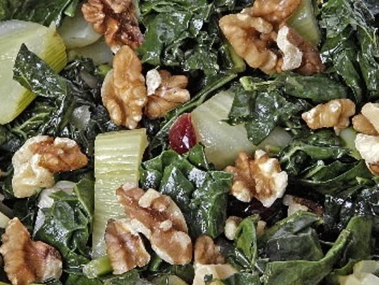 MCT photo: Could kale be a super veggie? It is shown here in a recipe by Ellen Kanner that also features fennel, cranberries and walnuts.