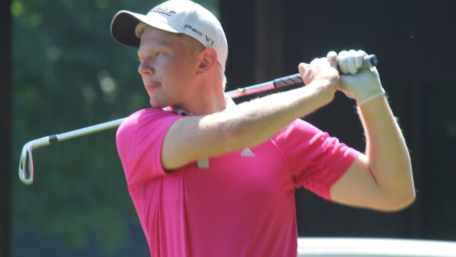 Chris Sloe watches his shot during the 90th Portage County Amateur, which took place Saturday and Sunday at Windmill Lakes Golf Club in Ravenna and Sugar Bush Golf Course in Garrettsville.
