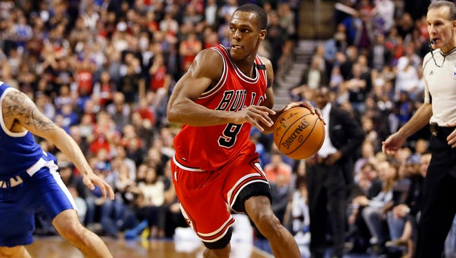 Chicago Bulls guard Rajon Rondo (9) dribbles the ball against the Toronto Raptors at the Air Canada Centre. T