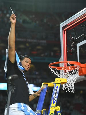 North Carolina Tar Heels forward Kennedy Meeks (3) cuts down the net after defeating the Gonzaga Bulldogs in the championship game of the 2017 NCAA Men's Final Four at University of Phoenix Stadium.