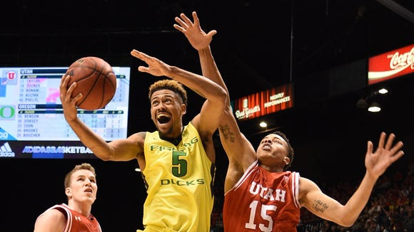 March 12, 2016; Las Vegas, NV, USA; Oregon Ducks guard Tyler Dorsey (5) shoots the basketball against Utah Utes forward Jakob Poeltl (42, left) and guard Lorenzo Bonam (15) during the second half in the championship game of the Pac-12 Conference tournament at MGM Grand Garden Arena. Mandatory Credit: Kyle Terada-USA TODAY Sports