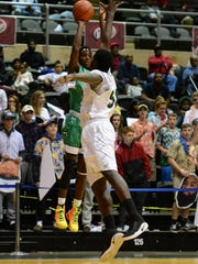 Parkside's Tyrese Purnell takes a shot against C.H. Flowers during the Governor's Challenge at the Wicomico Civic Center on Tuesday, Dec. 26, 2017.