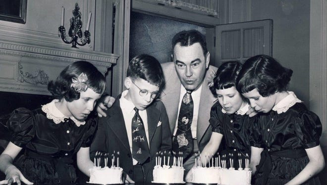 Kentucky Gov. Lawrence Wetherby, center, helps blow out the candles on the four birthday cakes for the Lashley quadruplets in 1951 at the Governor's Mansion in Frankfort.  They are, from left, Martine, John, Beulah and Mildred.