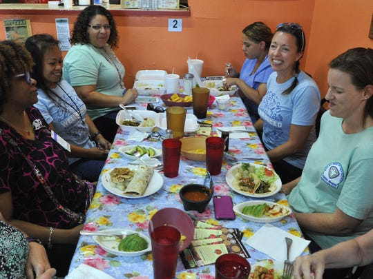 Wichita County Health Department employees enjoy lunch items from Gutierrez Eat Well menu. Eat Well is part of a joint effort between the Health District and the Health Coalition of Wichita Falls.