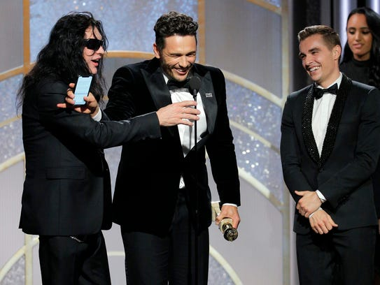 "Tommy Wiseau, left, jokes with James Franco of ""The"