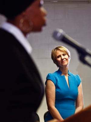 New York candidate for governor Cynthia Nixon, right, listens as she is introduced by Zakiyah Ansari, left, with the Alliance for Quality Education, during her first campaign stop at the Bethesda Healing Center church, Tuesday March 20, 2018, in the Brownsville section of Brooklyn.