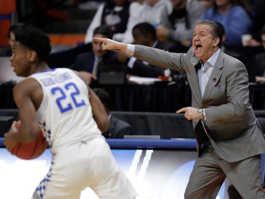 Kentucky coach John Calipari, right, calls to his team as guard Shai Gilgeous-Alexander (22) heads downcourt during the first half of a first-round game against Davidson in the NCAA men's college basketball tournament Thursday, March 15, 2018, in Boise, Idaho. (AP Photo/Ted S. Warren)