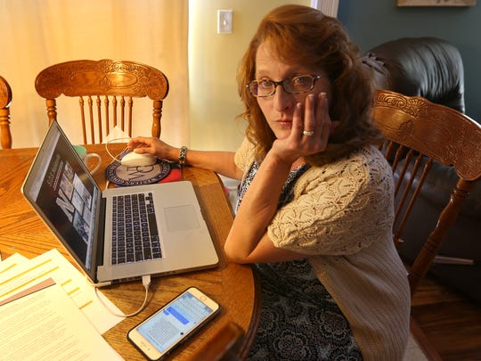 Lisa Duell works in her Noblesville home, Friday, June 8, 2018.  She and other parents are working together in a grassroots parent group in Noblesville calling for changes to increase school safety.
