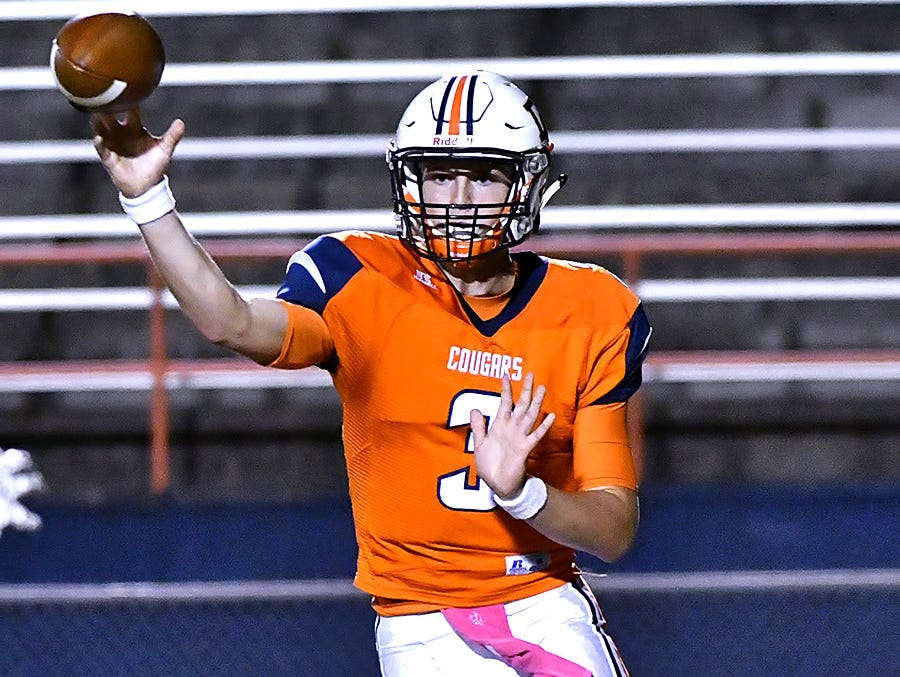 Dickson County quarterback Jacob Murphree completes a pass during the Cougars 38-28 win over Clarksville.