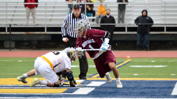Scarsdale's Seth Thornton wins a faceoff in the second half of Tuesday's 11-9 loss to Pelham at Glover Field.