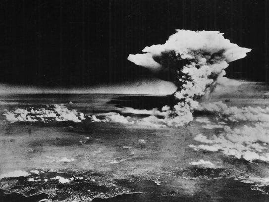 A mushroom cloud billows about one hour after the nuclear