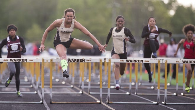 Kayland Jackson, Warren Central High School, cruises to her meet record 14.08 in the girls 100 hurdles, Metropolitan Interscholastic Conference Warren Central High School track and field meet, Indianapolis, Tuesday, May 2, 2017.