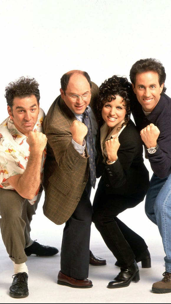 """-  -FILE--The cast of NBC's """"Seinfeld,"""" is shown in this undated handout photo. NBC has sold two 30-second commercials on the final original episode of ``Seinfeld'' for a television record $2 million each. Pictured from left are; Michael Richards as Kramer, Jason Alexander as George Costanza, Julia Louis-Dreyfus as Elaine Benes and Jerry Seinfeld as Jerry Seinfeld. (AP Photo/Columbia/TriStar Television Distribution)"""