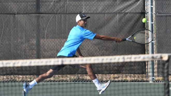 Pueblo West senior Joey Cruz tracks down a backhand during he and his partner's No. 3 doubles match against Discovery Canyon on Sept. 11 at Pueblo West.