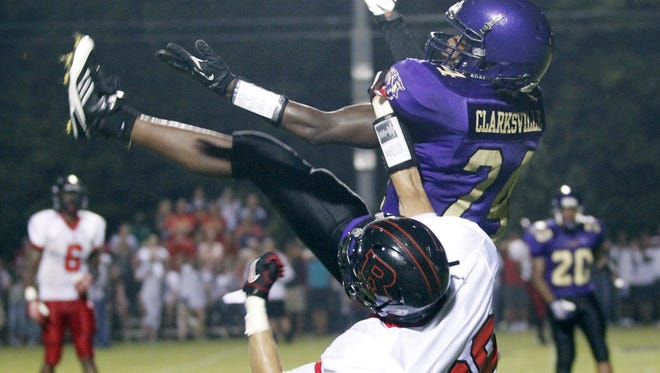 Clarksville's Derwin Whitt (24) breaks up a pass intended for Rossview's Christian Christenson (39) during a game in 2013.