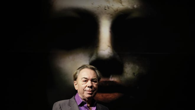 """British composer Andrew Lloyd Webber promotes his new production """"Love Never Dies"""" at a theater in London, Thursday Oct. 8, 2009.  The new musical continues the story of """"The Phantom of the Opera"""".  (AP Photo/Matt Dunham)"""