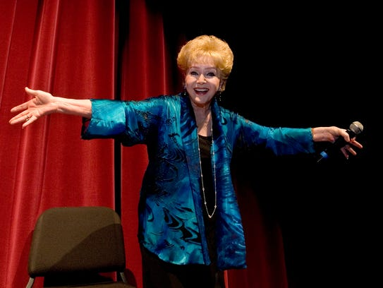 "Debbie Reynolds, co-star of ""Singin' in the Rain,"""