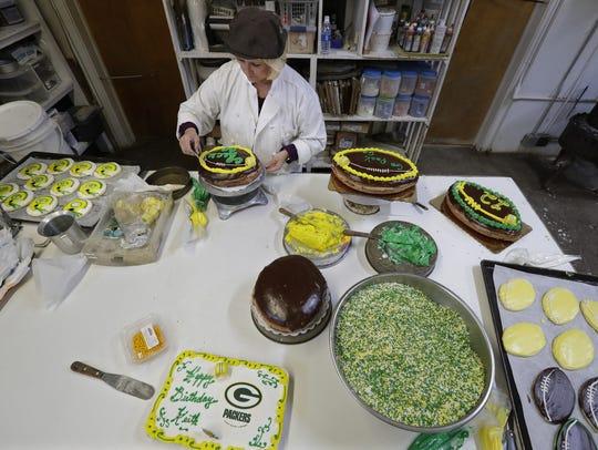 Co-owner Lynn Engel decorates a variety of Green Bay