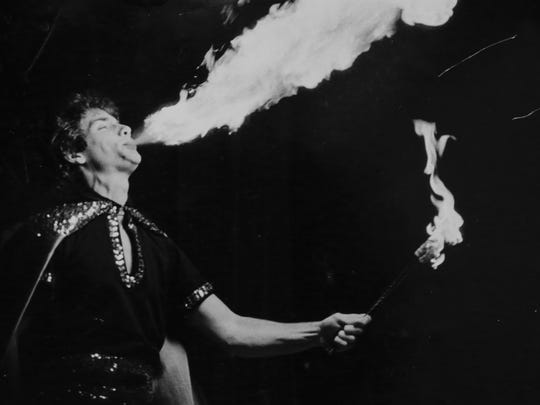 David DeYoung, Dick's son, breathing fire during a performance. David regularly performed in his father's shows.