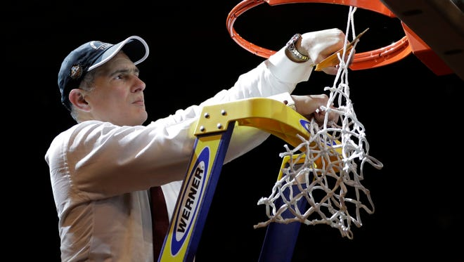 South Carolina head coach Frank Martin cuts down the net after beating Florida 77-70 in the East Regional championship game of the NCAA Tournament in New York on Sunday.