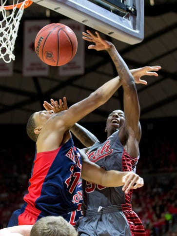 Utah's Delon Wright, right, crashes into and his fouled
