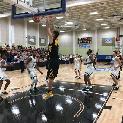 Iowa center Luka Garza goes up for a dunk that punctuated