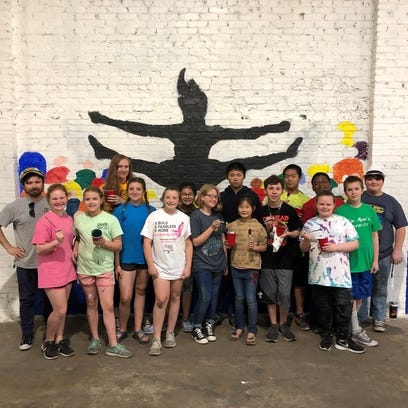Sixth-graders from Sallie Humble Elementary painted
