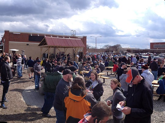 Chlly weather didn't discourage a crowd from turning out for the 2014 Michigan Cask Ale Festival at Ashley's Beer and Grill in Westland.