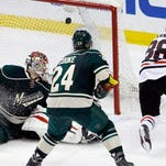 Chicago Blackhawks right wing Patrick Kane (88) and Minnesota Wild left wing Erik Haula (56), of Finland, chase the puck during the second period of Game 6 of an NHL hockey second-round playoff series