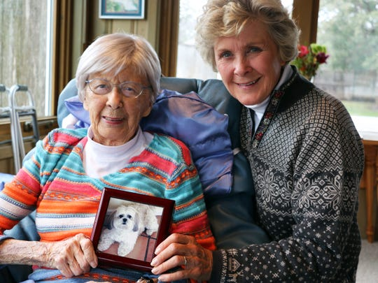 Betty McCoy, left, and her daughter, Kathy, are pictured in McCoy's home with a photo of the 89-year-old woman's late pet dog, Sophie, 16, who was euthanized the day after Thanksgiving. McCoy, who has lived with stage 4 lung cancer for four years, donated $15,000 to the Winneshiek County Sheriff so that the department could replace its police dog that died of brain cancer.