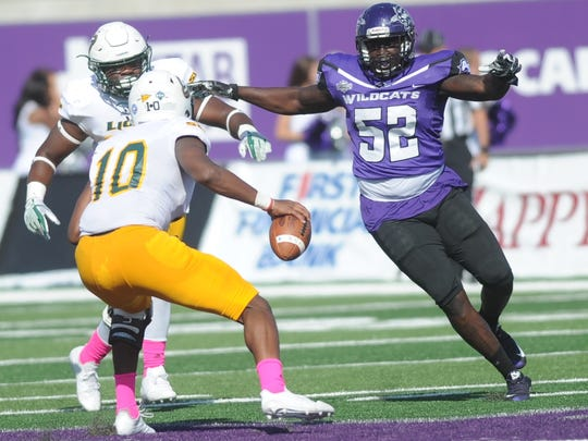 ACU's Core Smith (52) puts pressure on Southeastern Louisiana quarterback Lorenzo Nunez in the first half. The Lions beat ACU 56-21 in the Southland Conference game Saturday, Oct. 21, 2017 at Wildcat Stadium.