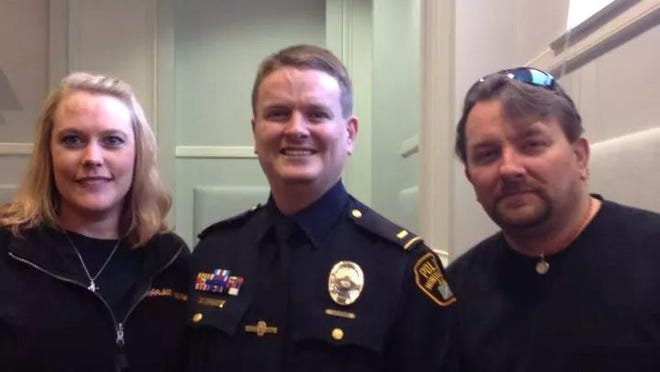 Lt Rian Rider, middle, at a recent promotion ceremony.