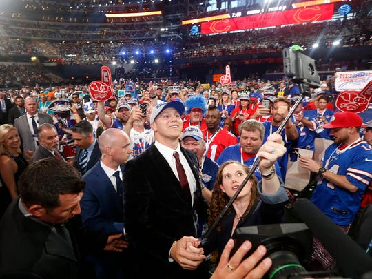 Wyoming's Josh Allen, center, takes a selfie of himself with Buffalo Bills fans after being selected by the team during the first round of the NFL football draft, Thursday, April 26, 2018, in Arlington, Texas. (AP Photo/Michael Ainsworth)