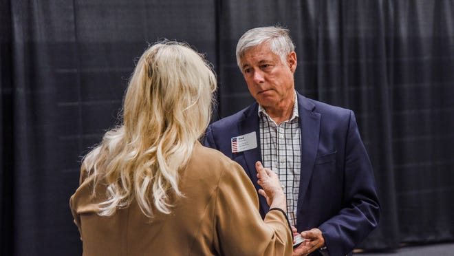 Rep. Fred Upton, R-St. Joseph, speaks with an individual at an event in Holland in June 2019. Upton was among legislators introducing a bill to provide relief funding for research institutions impacted by the coronavirus pandemic.