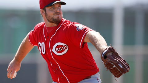 Cincinnati Reds relief pitcher J.J. Hoover (60) throws during live batting practice at Cincinnati Reds spring training, Thursday, Feb. 25, 2016, in Goodyear, Arizona.