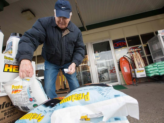 Phil Ebert of Kennett Square picks up a bag of ice melt mixture at Fairfax Hardware on Concord Pike as they prepare for the coming snow storm.