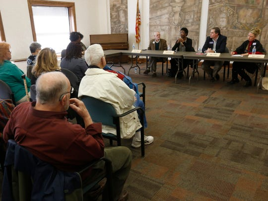 Springfield school board candidates participate in a NAACP forum at the Midtown Carnegie Library on Saturday, Mar. 19, 2016.