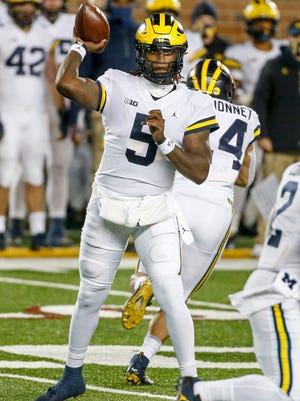 Michigan quarterback Joe Milton passes against Minnesota in the first quarter of an NCAA college football game Saturday, Oct. 24, 2020, in Minneapolis. (AP Photo/Bruce Kluckhohn)