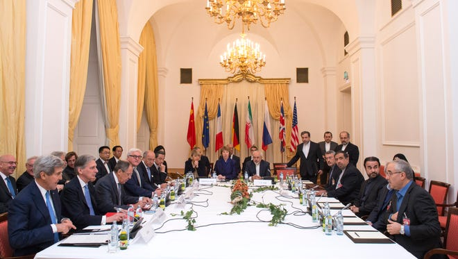 Delegations sit around the negotiations table during talks about Iran in Vienna on Monday.